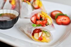 Kiwi Strawberry Spring Rolls with Vanilla Lime Honey Dipping Sauce by howsweeteats.  #Spring_Rolls #Kiwi #Strawberry #howsweeteats