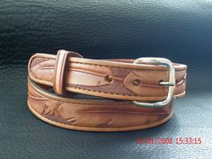 Hand tooled leather feather belt