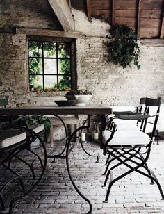 Our current modern, completely charmless back wall of the house would be transformed by this. Add a lintel, potted herbs and rustic seat...
