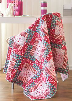 This cheerful and easy to make throw sized quilt features strip sets.
