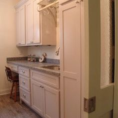traditional laundry room by Soorikian Architecture  I like the pocket door.