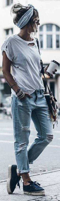 Everything is a dress down. the torn t shirt. The torn jeans. The messy hair. But then the bandana. CHIC. summer street style ideas