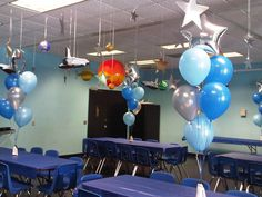 Simple balloons for stage front? Silver or gold stars with navy blue, cub blue and pale yellow?