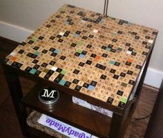 Another Scrabble tile idea -- Hubby could make  http://www.readymade.com/projects/scrab_tab
