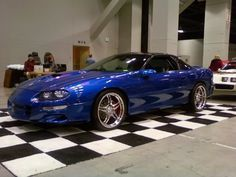 '98 SS Camaro with a 408 in long beach blue pearl. Aside from the sonic blue Cobra's this is the best looking blue paint job I have seen.