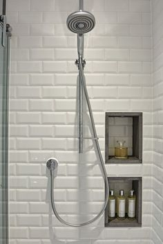 Creative shower area with white metro wall tiles and recessed storage. The basalt edging finishes the recesses and creates visual detail. I Family Bathroom Design | Sapphire Spaces - Image Alt