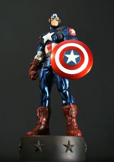 """Ultimate Captain America Variant statue Sculpted by: Tron and Randy Bowen  Release Date: December 2011 Edition Size: 1380 Order Of Release: Phase IV (statue #261)  Stands 13.5"""" tall  (Metallic blue costume variant)  Note: Bowen Designs Website Exclusive"""