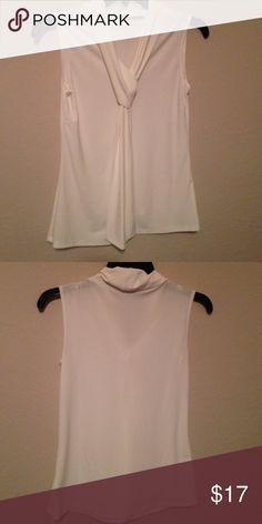 FREE GIFT for purchases made before 12/25 Made of polyester and spandex. V neck that turns into a tie. Tops