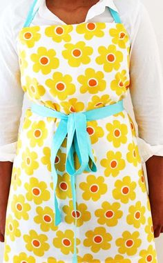 Make a simple apron from your favorite bright, cheery fabric! These easy aprons make for great gifts.
