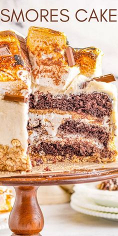1 reviews · 1 hour · Serves 12 · Smores Cake - A three layer showstopping cake that everyone will ADORE! Moist and tender layers of chocolate cake along with crunchy graham cracker crusts, sweet marshmallow buttercream frosting… Toasted Marshmallow, Marshmallow Buttercream, Buttercream Frosting, Delicious Desserts, Dessert Recipes, Yummy Food, Tasty, Bakers Chocolate, Chocolate Cake