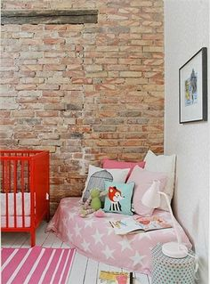This link leads to lots of photos of nooks, not specific how-tos. I would have so loved this as a kid. reading corners, kid bedrooms, cozy corner, cozy nook, kid rooms, girl bedrooms, reading nooks, exposed brick, girl rooms
