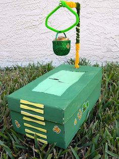 Glued papers to the underside of the box lid, so that when the Leprechaun goes for the pot of gold, he'll fall into the box. http://hative.com/cool-diy-leprechaun-trap-ideas/
