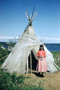 Young woman from Webequie outside tipi' ~ (Anishinaabe) ~Neskantaga, 1956