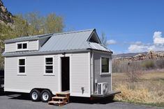 A custom-built tiny house on wheels in Vernal, Utah. Shared and owned by Brett Ranch. Built by Living Large Tiny Homes