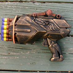 Two toy guns melded into a custom steampunk weapon. Description from pinterest.com. I searched for this on bing.com/images