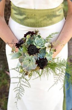 I know this bouquet is the focus of the photo but what I really like the is the raw green silk sash.