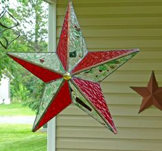 Youll see them on almost any drive through farm country- barn stars made from wood, metal, or just painted on a building. Theyre popular because theyre rustic folk art, and because theyre considered lucky. I decided to try my luck making them out of stained glass, and I hope youll be as happy with the result as I am. This one is made from textured ruby-red stained glass, alternating with clear art glass decorated with fractures and streamers- chips and filaments of red and green glass melted…