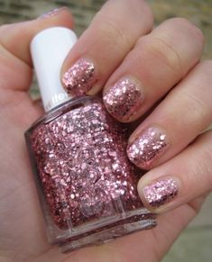 Essie-A-Cut-Above-Luxe-Effect . . . obsessed with this glitter color, especially as it looks less pink and more rosy-gold in person and the different sized glitter gives the appearance of beaten metal--subdued glam at it's best!