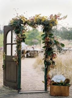 Love the idea of a doorway at an outdoor wedding.