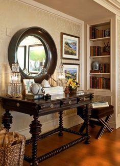 HAMPTONS LIVING : British West Indies style foyer. The deep circular mirror frame is esquisite.