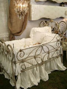 Every time I see this crib repinned, I cringe. Beautiful, yes. Safe, no. Those pillows and bumpers are not recommended, and the scrolled sides look like entrapment hazards. And just wait until baby is standing...would probably fall out.