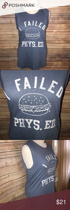 Junk Food 'I Failed Phys Ed' Sleeveless Tee Super fun and cheeky! Great cobalt blue shade with white cheeseburger Graphic and 'I Failed Phys Ed' lettering. BNWOT, excellent quality and condition. Check out my other listings to bundle and save! Junk Food Tops Muscle Tees