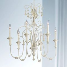Check CHANDELIER Scrolled Tiers Wide Antique White Chandelier Six arms curve out and upwards in this wonderful hand-finished antique white chandelier. Decorative scrolled tiers add a. Chandelier Lighting Fixtures, White Chandelier, Antique Chandelier, Chandeliers, Chandelier Ideas, Light Fixtures, Painted Chandelier, Living Room Lighting, Bedroom Lighting