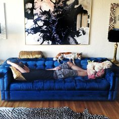 amazing blue sofa and art