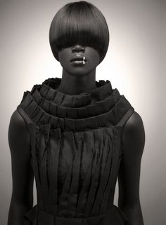Pleated black dress with creative layered pleat detail - structural fabric manipulation for fashion; couture sewing // Saadique Ryklief