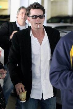 Charlie Sheen with his e-cig. Get yours today at deluxecig.com