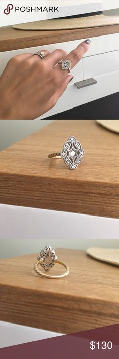 Beautiful vintage filigree style statement ring Beautiful vintage filigree style statement ring purchased at a popular boutique in Japan. Size 6.5. Sterling silver head, and 18K gold plated around the band. High quality cubic zirconia placed elegantly. Jewelry Rings