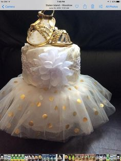 Tutu diaper cake etsy 12 super cute diaper cake ideas for baby showers Diy Diaper Cake, Nappy Cakes, Girl Diaper Cakes, Unique Diaper Cakes, Cake Baby, Diaper Cake For Girls, Small Diaper Cakes, Diaper Crafts, Diaper Cake Centerpieces