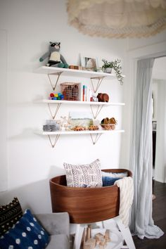 pretty shelving (done with West Elm Antique Brass Prism shelves) || From Kitchen Dwelling to Baby Nook.