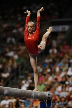 Nastia Liukin in an incredible arabesque on beam. Such turn-out!
