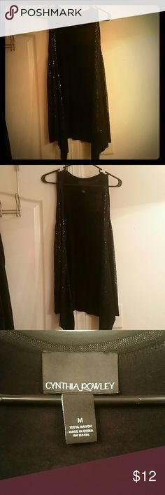 Long, black, sequined vest This thin vest has sequins going down the front and hangs slightly longer in the front. The black is plain with no sequins, perfect to wear over a cute cotton dress to add something extra! Cynthia Rowley Tops