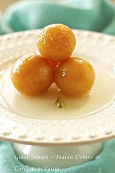 Gulab Jamun are Indian donuts made with pure milk powder, fried and soaked in a cardamom scented syrup.