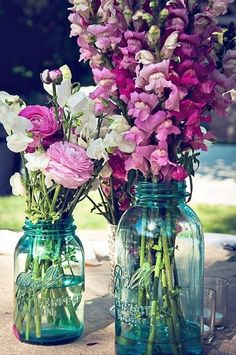 Pretty pink & white flowers in blue mason jars