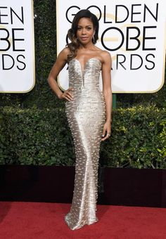 Actress and nominee Naomie Harris dazzled in an off-the-shoulder silver dress as she arrived at the 74th Annual Golden Globe Awards at The Beverly Hilton Hotel.
