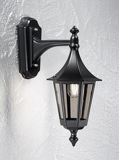 LA1603-1 Boulevard down lit wall lantern small, matt black aluminium. Italian matt black die-cast aluminium fitting with smoked polycarbonate lenses. 1 x 60w E27 Lamp not included Height- 44cm Width- 18.5cm Projection- 29cm BRAND- Franklite REFERENCE- LA1603-1 AVAILABILITY: 3-4 Working Days