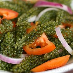 Lato seaweed - fijians call these sea grapes and serve them with fermented coconut, chillies and green onion...interesting