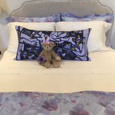 Hermes Pillow on girls room bed. Features purple tones perfect for our clients daughters bed.   Vintage Hermes Pillows. Hermes Bedroom.  Little girls room decor. Teddy bear bedroom. Purple Hermes, Hermes Decor