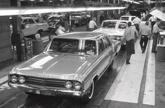 This Plant Engineering Department photo from the files of Oldsmobile's Lansing Assembly recorded 1964 Oldsmobiles as they reached the end of the line in the drive-off area. Car Photos, Car Pictures, Oldsmobile 442, Assembly Line, S Car, American Muscle Cars, General Motors, Buick, Motor Car