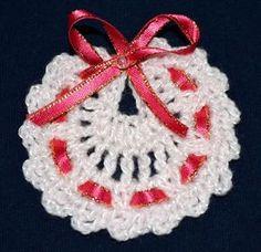 Souvenirs modelo babero para bebe tejido a crochet