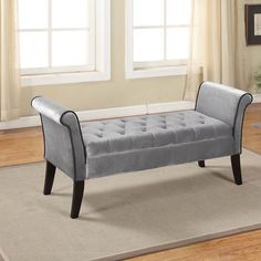 With a storage area under the seat, this classic styled bench is a tasteful addition to your home. The curved armrests and buttoned velvet seat beckon guests to be seated in luxury. master bedroom