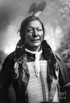 "DAKOTA SIOUX~ c1891. ""Fire Lightning"" Dakota Sioux Native American man,wearing a bone breastplate. ~Photographed by: Charles Milton Bell, c1891"