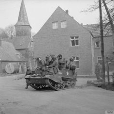 Universal carrier and airborne troops in Hamminkeln during the landings east of the Rhine, 25 March 1945.