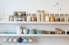 Nice arrangement of storage jars on open shelves