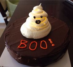 Flickering meringue ghost floating on chocolate stout cake