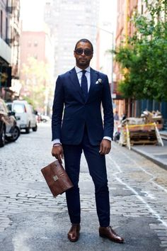 Navy suit, navy tie and brown shoes.