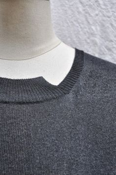 Grey sweater dress with asymmetric neckline; contemporary knitwear design details // Worthwhile